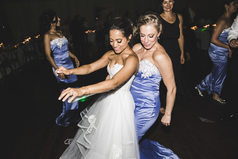 bride dances with bridesmaid
