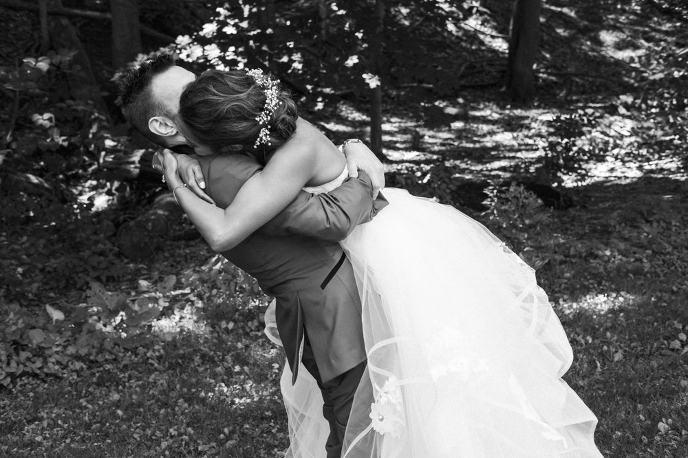 Bride hugs groom during first look