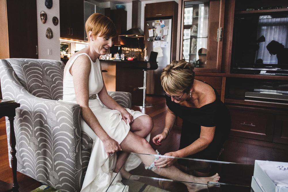 mother helps daughter put garter on