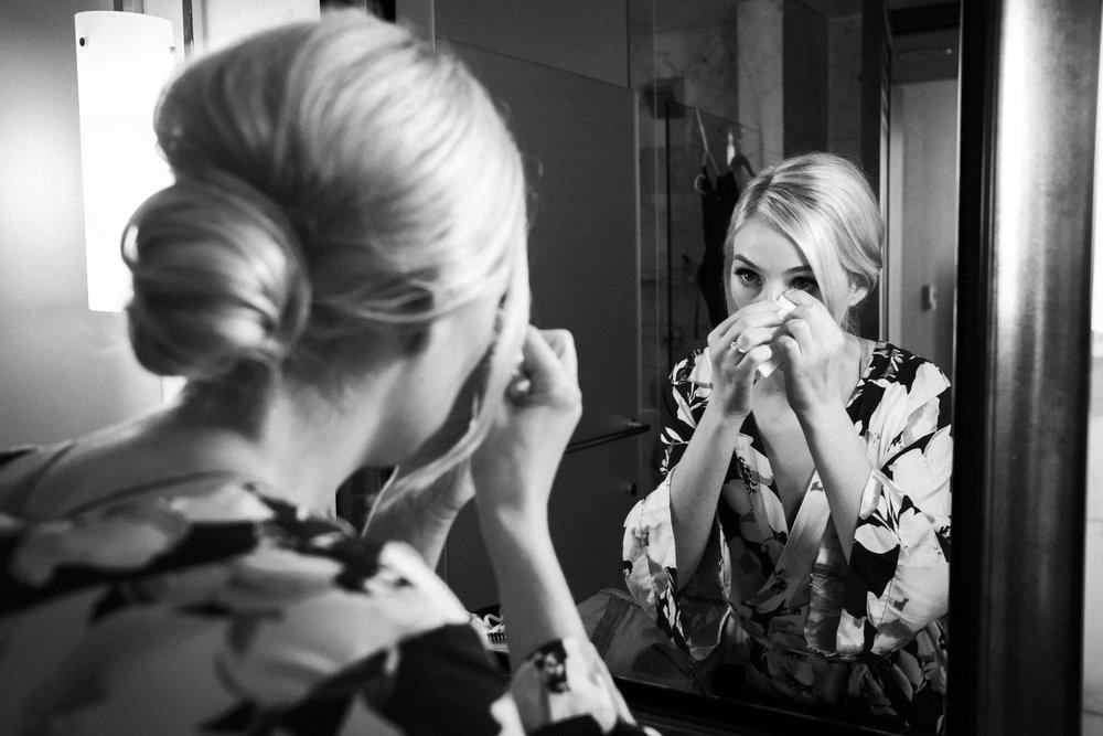 bride fixing makeup