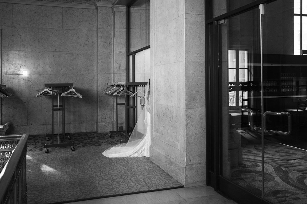 bride hiding before first look with groom at one king west hotel in toronto