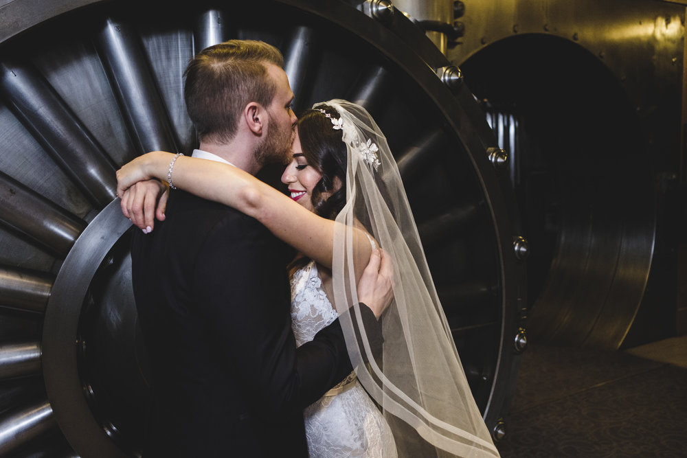 bride and groom portrait at the vault inside one king west hotel