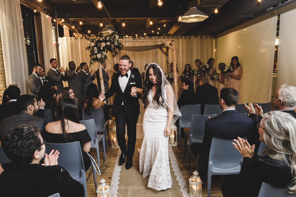 bride and groom's joyful recessional after their wedding ceremony at 2nd floor events in toronto