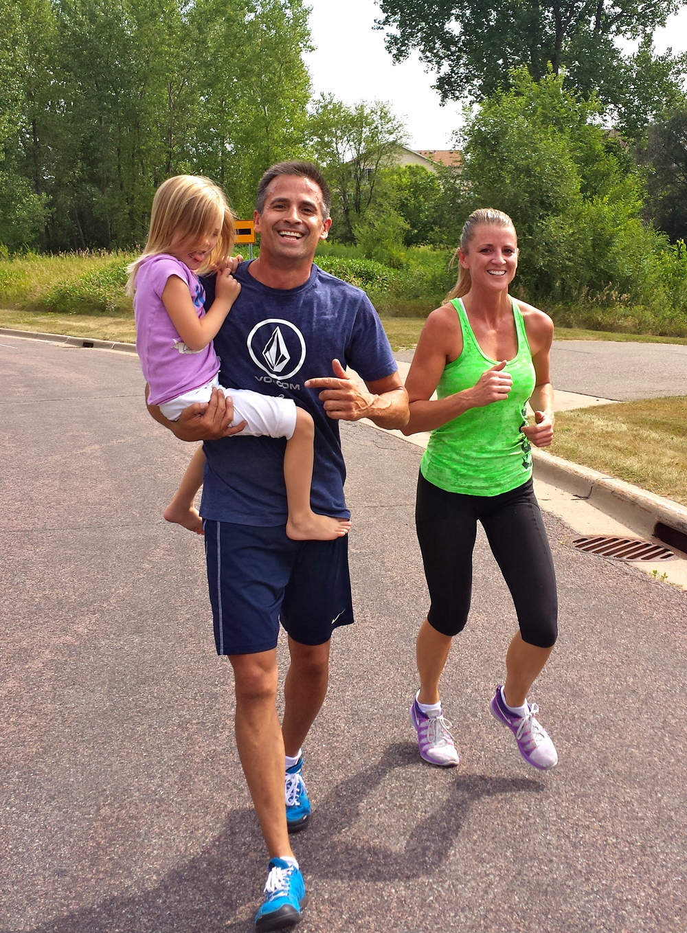 Paul and Michele carrying their daughter during med ball partner runs last Saturday