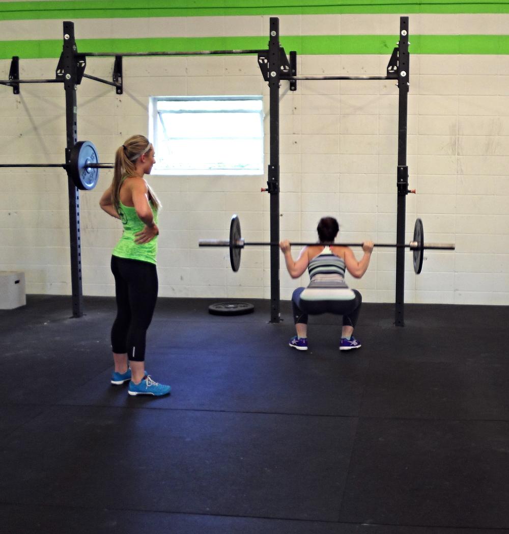Lindsay H. and Liz P. warming up back squat