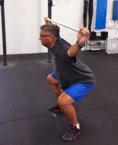 Dave F. working on his overhead squat technique.