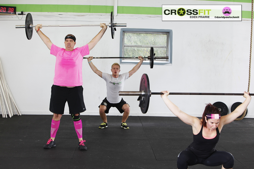Overhead Squatting & Jim C. representing breast cancer awareness month in true hot pink fashion.