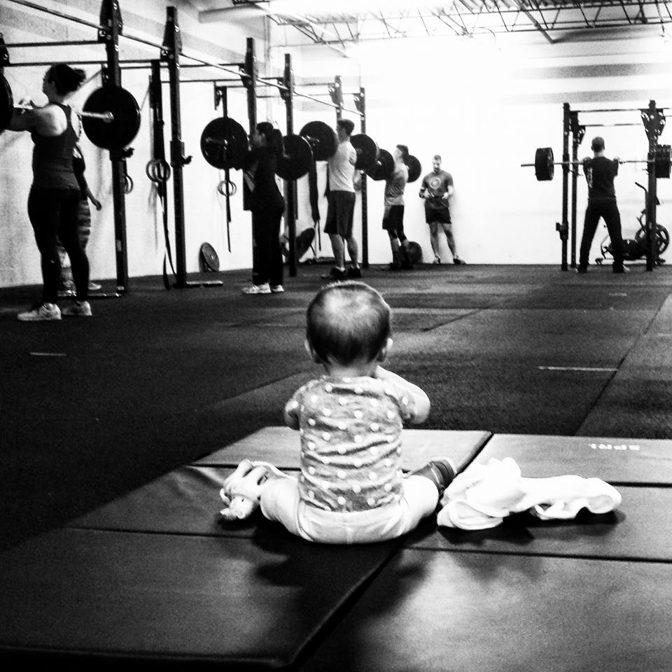 In honor of the real gym boss's 2nd birthday on Monday -- here is a throwback of Hadley at 7 months old keeping us all in line as we lift.