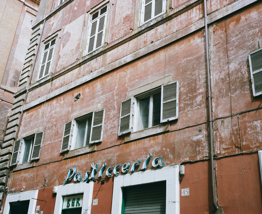 Pasticeria sign on a pink building, Rome, Italy