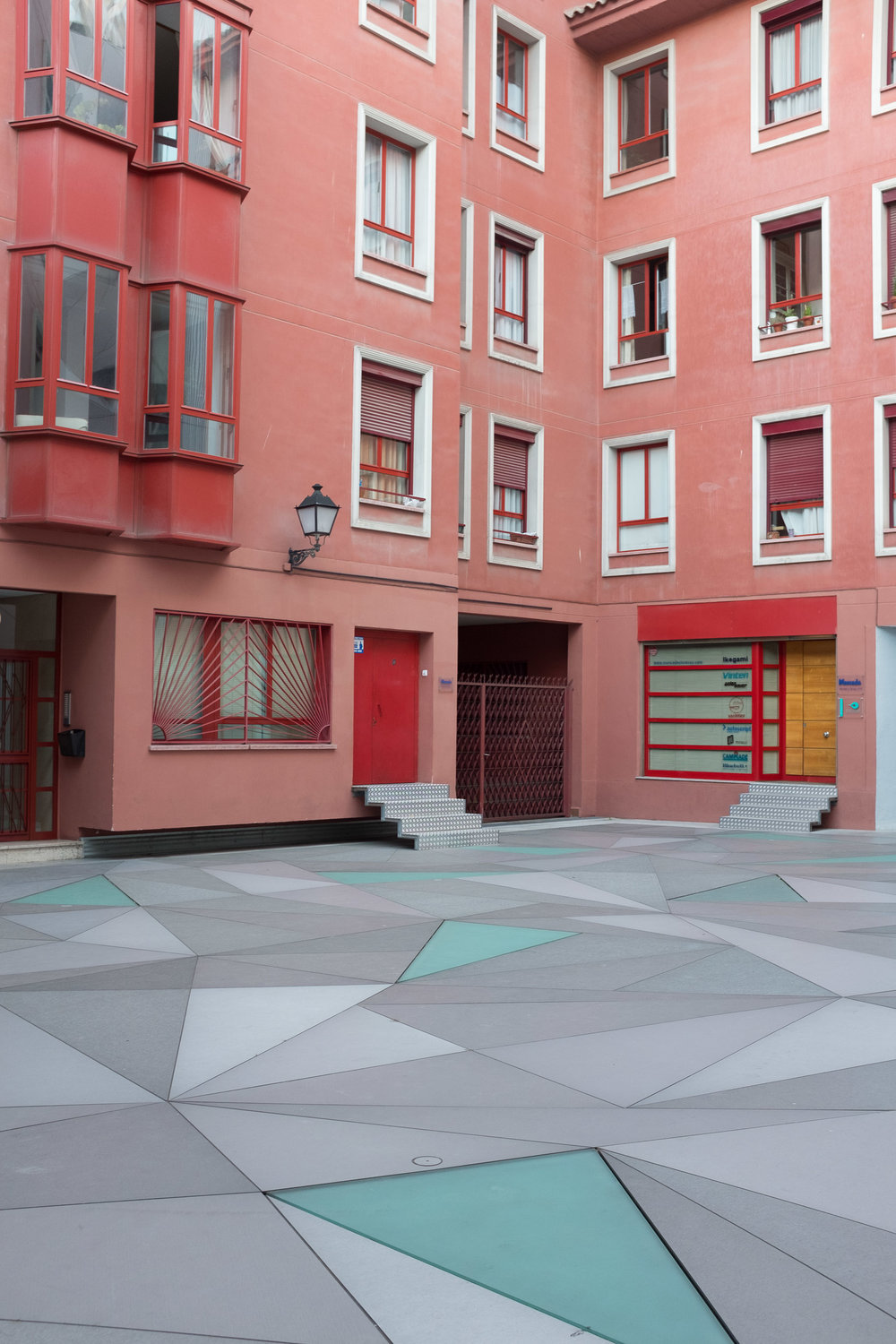 Pink builing with geometric courtyard in Madrid, Spain