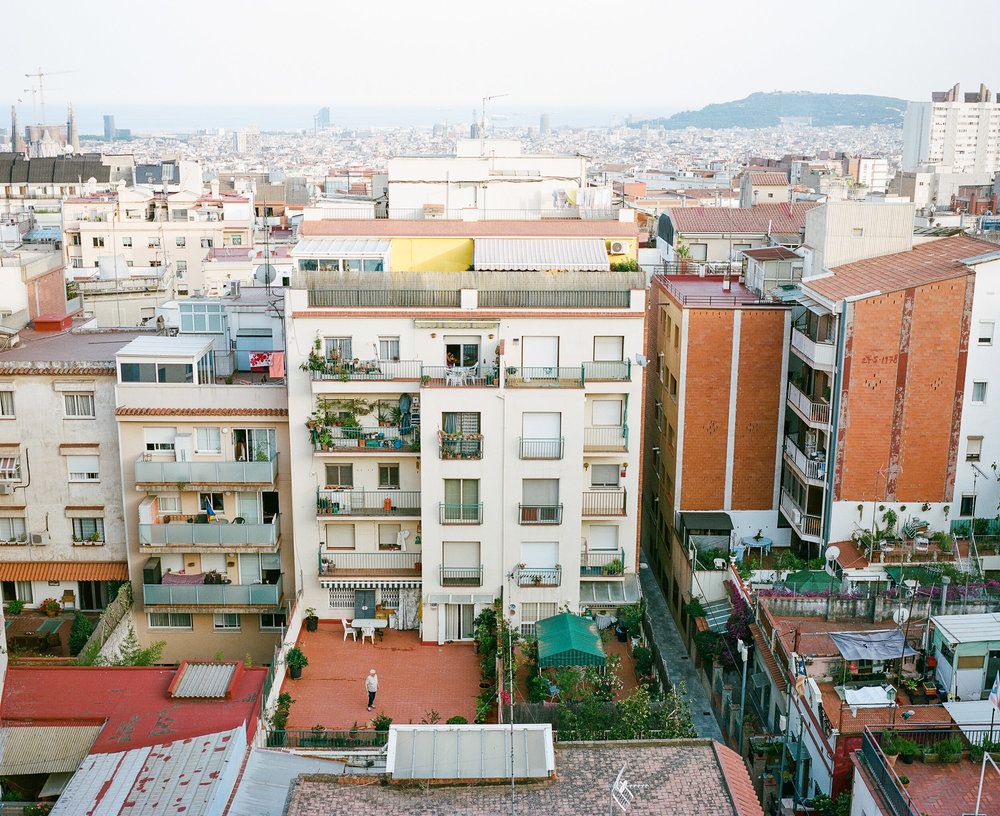Rooftop view in Barcelona, Spain- Man on rooftop