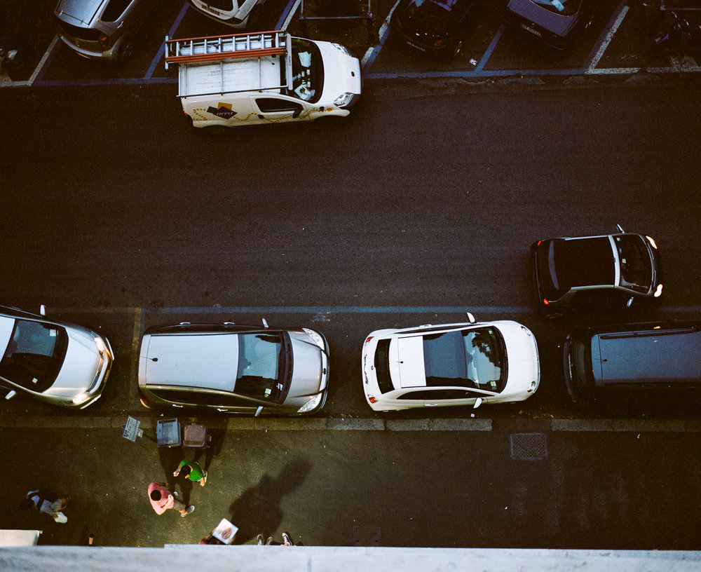 Cars and people on the street from above in Rome, Italy
