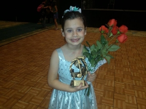 Emma, only 6 stole second place in Youth ages 7-12 at the Civic Center Talent Show 2014