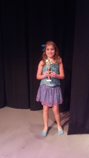 Tori and her first place trophy for best in age 7-11 vocal solo for the TC Parenting Magazine Talent Show 2013