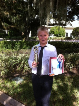 Luke and his first place trophy for best overall instrumental solo for piano at the Treasure Coast Parenting Show!