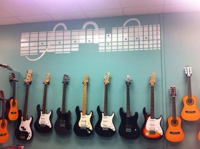 GUITARS ANYONE?MR. ELVISIS READY FOR YOU