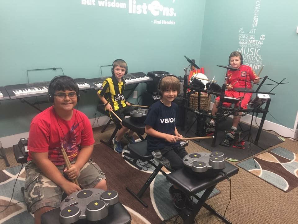 Small group drumming classes allow us to learn paradiddles, singles, doubles and drum reading on drum technique pads and then transition to playing on a roland professional  set.