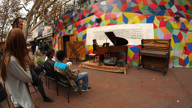 Allison Lovejoy and the growing crowd at our Market St. spot between 6th and 7th. liberated piano on left and prepared piano to the right.