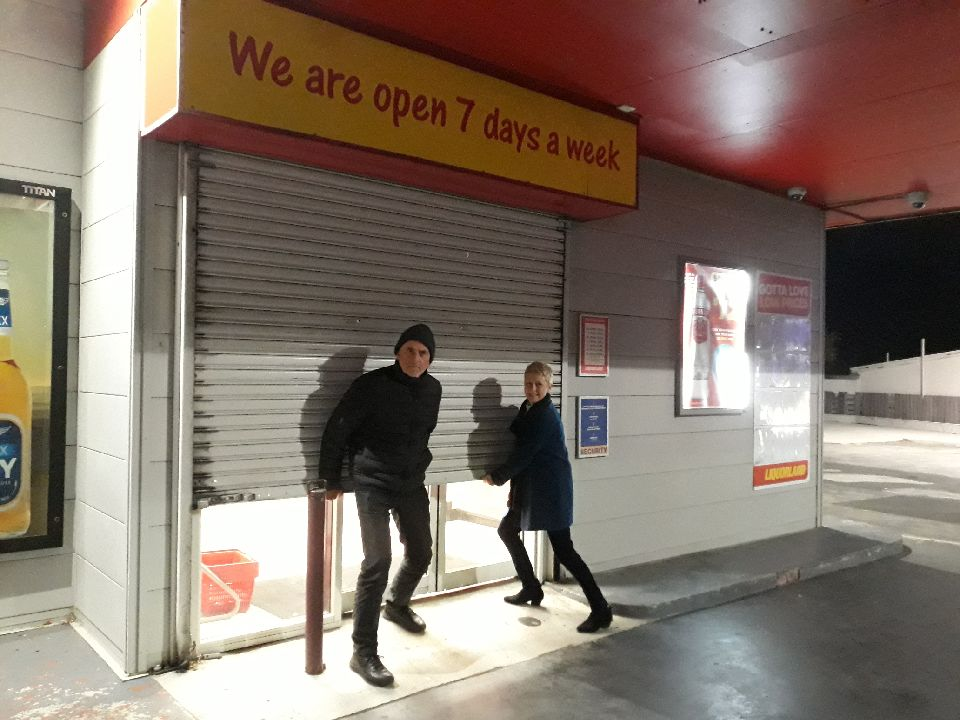 Local avengers David Watson and Janette Willett attempt to keep their drive-in bottlo open on the night it closed forever (17 June 2018) to make way for WCX.  RIP LIQUORLAND 1986-2018