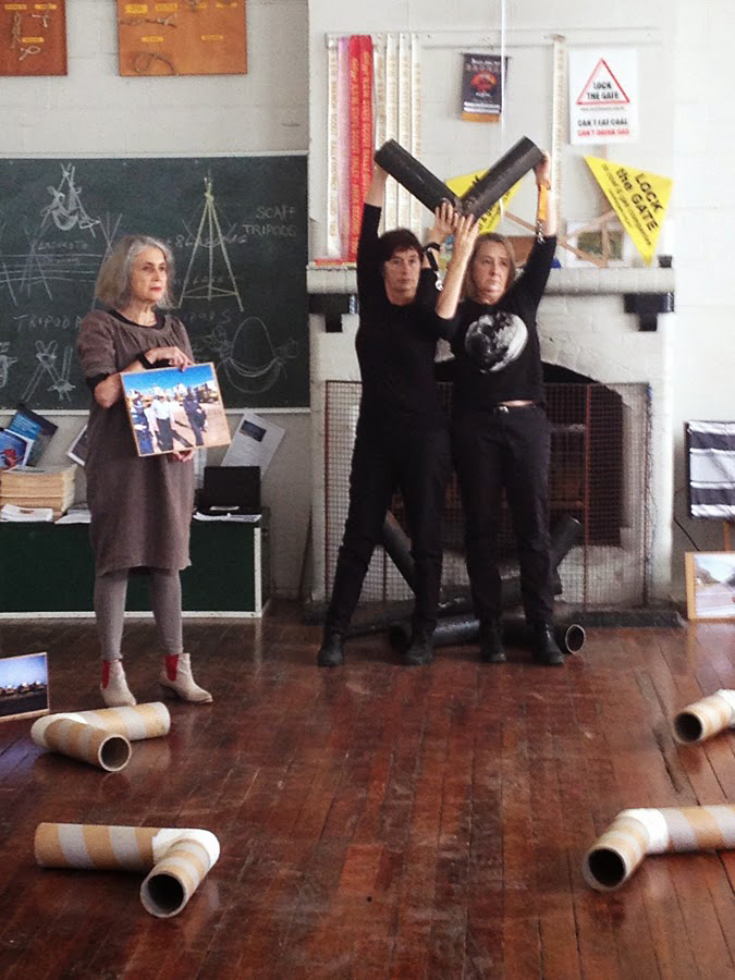 WRVAP artists (l. to r.) Toni Warburton, Suzanne Bartos and Juliet Fowler-Smith mid-performance… Toni 'witnessing' the arrest of 93-year-old Bill Ryan (whose 'activist portrait' she holds) protesting Whitehaven's Werris Creek coal mine in 2014.