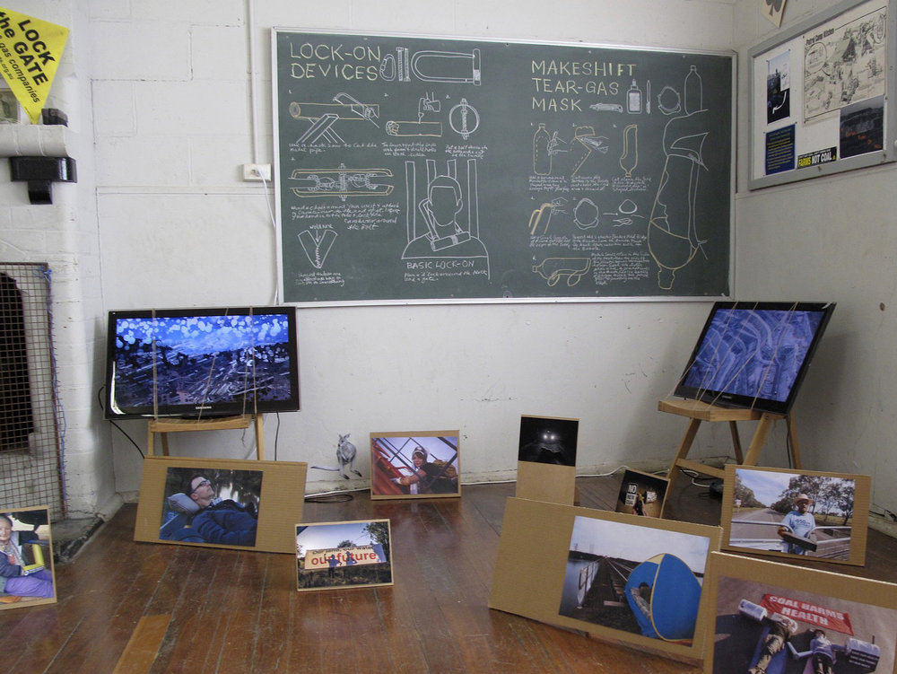 Noelene Lucas,  Death by Coal , 2015, videos, monitors, chairs, string, blackboard/chalk
