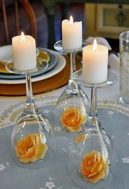 Inverted wine glasses as candle holders is such an easy and inexpensive way to display candles on a table.  And then you can add a rose or flower to match your colour theme.