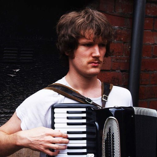 The before time in the long ago... I had a tash and played accordion in a folk group. #lifechoices 🤘🏻 . Taken round the back of my old flat 154a London Road, Sheffield by Jimmy Stone 2010 📸 . #tallwilliam #throwback #accordion #moustache #facialhair #photoshoot #photography #igersvienna #igerssheffield #singersongwriter #earlycartographers #younger #musician #titsout