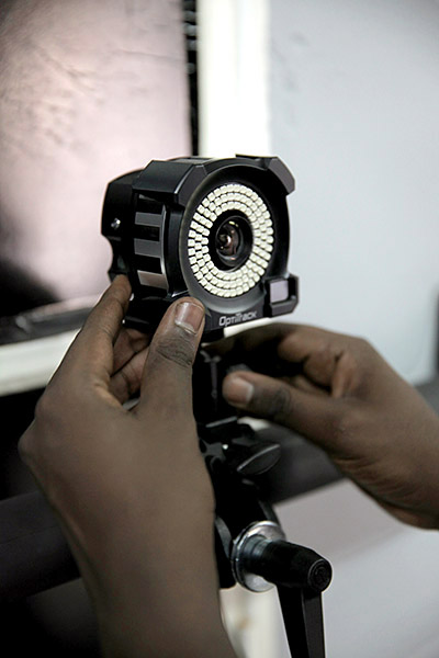 Jacques Karamutsa, an ADMA student, adjusts one of the motion capture cameras at ADMA's new motion capture studio in Kigali.