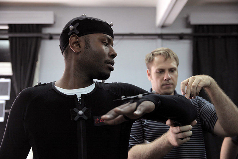 ADMA instructor Ryan Yewell places markers on student Patrick Ndaruhutse.