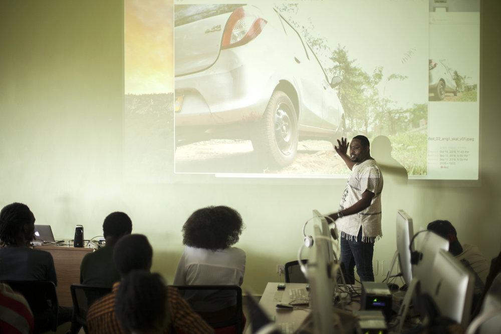 Cyril Ndegeya Giving Feedback On A Student's Photo