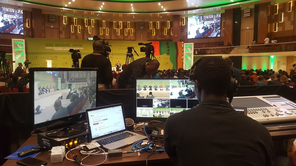 ADMA Student Bruce NSHIMIYIMANA at the controls of the livestream equipment at The African Green Revolution Forum at the Kigali Convention Center. Bruce and his team of ADMA students did the work of all of the livestreaming from the main auditorium using ADMA equipment.