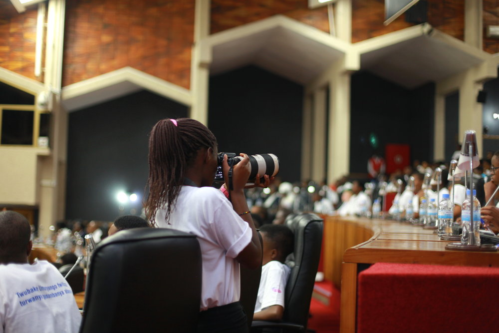 ADMA student Noella Claire, getting photos of the audience during the parliament session.