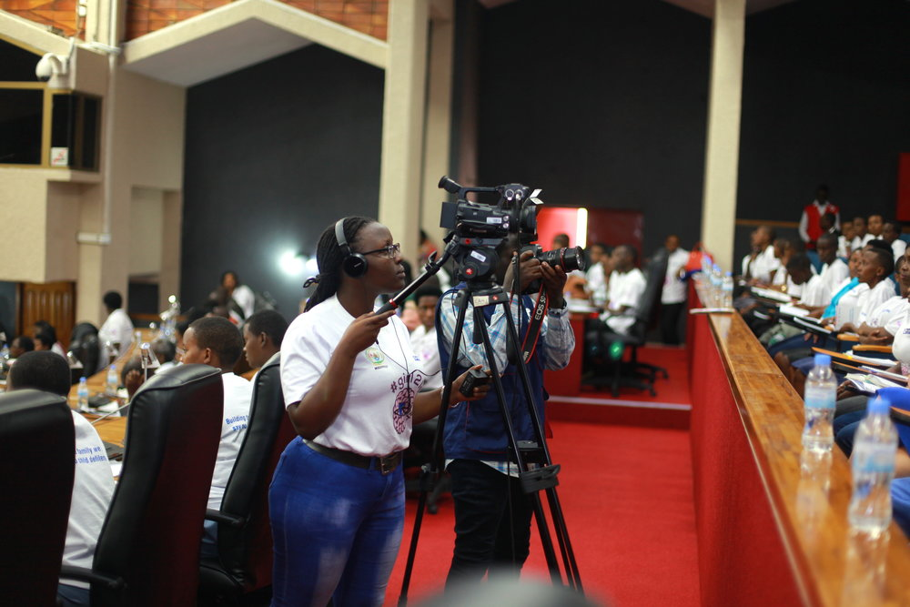 ADMA student Barbara, getting a video shot of the audience at the back of parliament.
