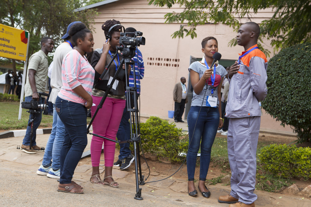 ADMA students Therese Mukundente, Sandrine Iragena, and Liliane Ikuze Filming at WorldSkills Competition at IPRC Kigali