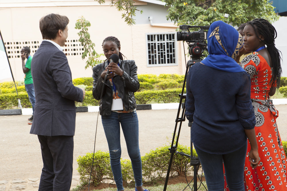 ADMA student Noella Claire Dushakimana sets up for an interview while her classmates look on during the WorldSkills competition at IPRC Kigali