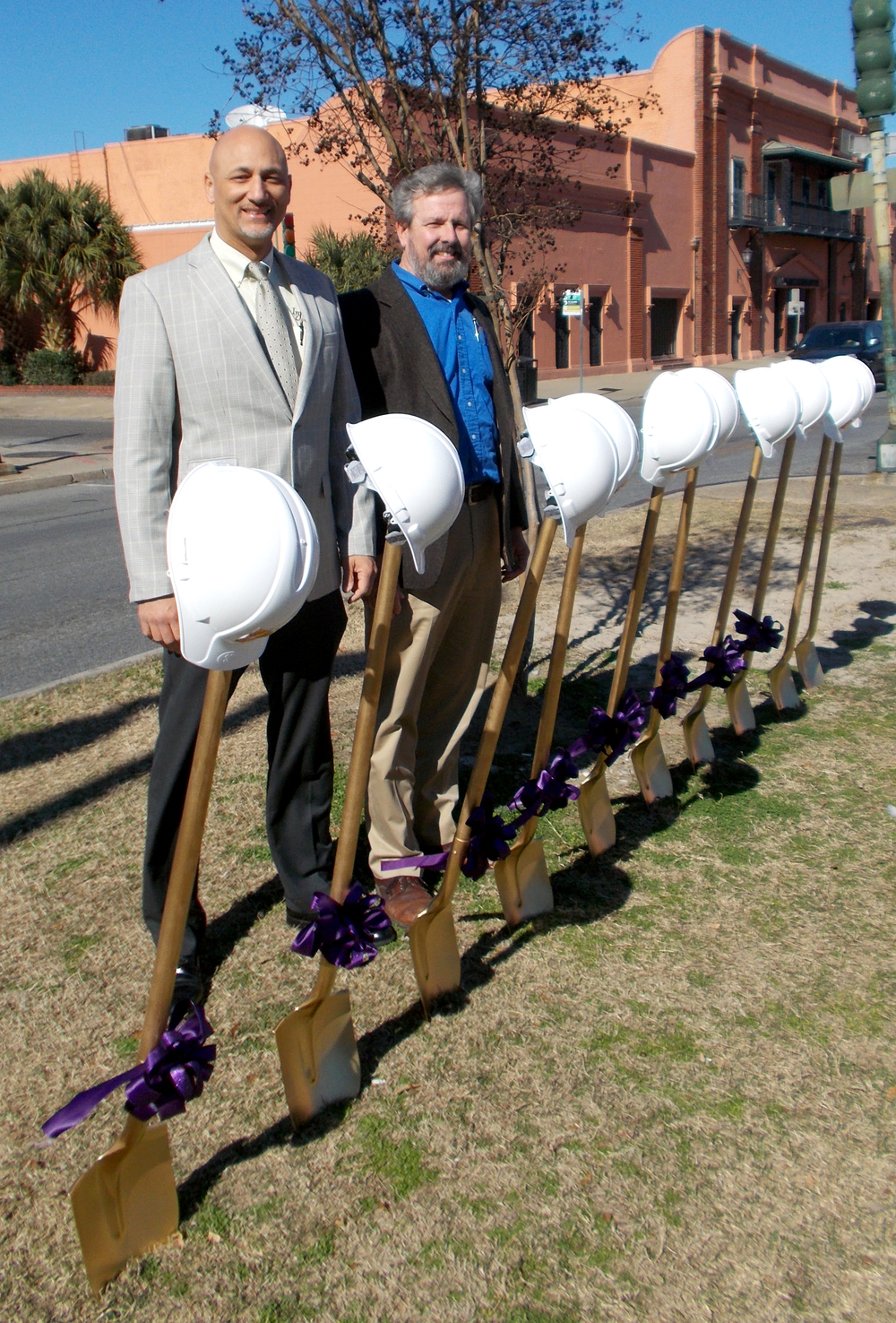 Infinity Engineering Consultants' Principal Raoul V. Chauvin, III, left, and Civil Engineer Michael Riviere stand before the ceremonial shovel at the Rampart Streetcar Line ground breaking ceremony on January 28, 2015.