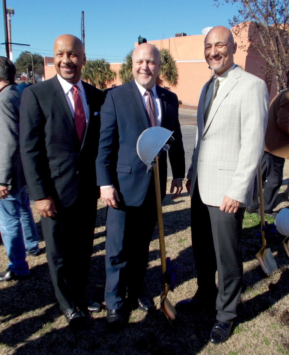 Regional Transit Authority CEO Justin Augustine, from left, New Orleans Mayor Mitch Landrieu, and Infinity Engineering Consultants, LLC Principal Raoul V. Chauvin, III celebrate the ground breaking of the Rampart Streetcar Line at the ceremony on January 28, 2015.