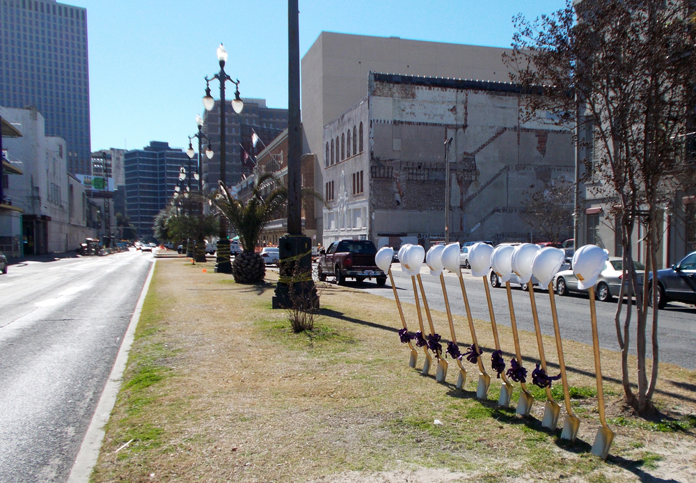 Ceremonial shovels and hard hats line the neutral ground on Rampart Street for the ground breaking ceremony of the Rampart Streetcar Line expansion on January 28, 2015.