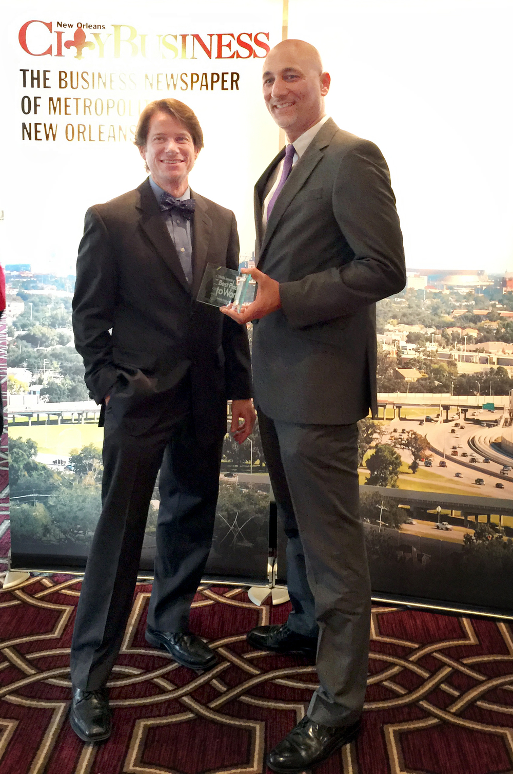 Infinity Principal Partners Bill Thomassie, left, and Raoul Chauvin, III, proudly accepted their third award as one of New Orleans' Best Places to Work.