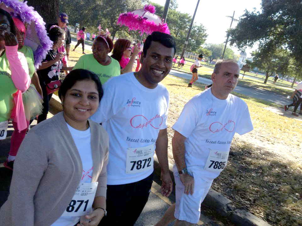 Infinity Race for the Cure team members, from left, Sushmeetha Annam, Vinay Ramesh and Mike Laux take part in the 5K walk on October 25.