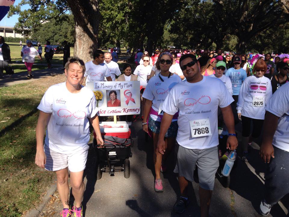 The Infinity Race for the Cure team walks together during the 2014 5K walk to raise awareness and funds for breast cancer.