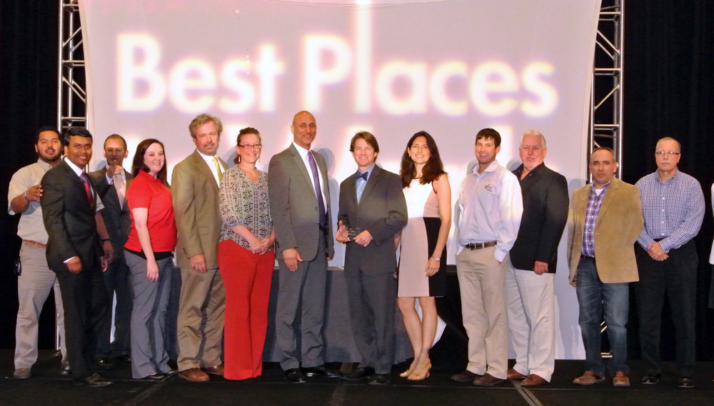 The Infinity Engineering Consultants team takes the stage to accept their award as one of New Orleans' Best Places to Work.