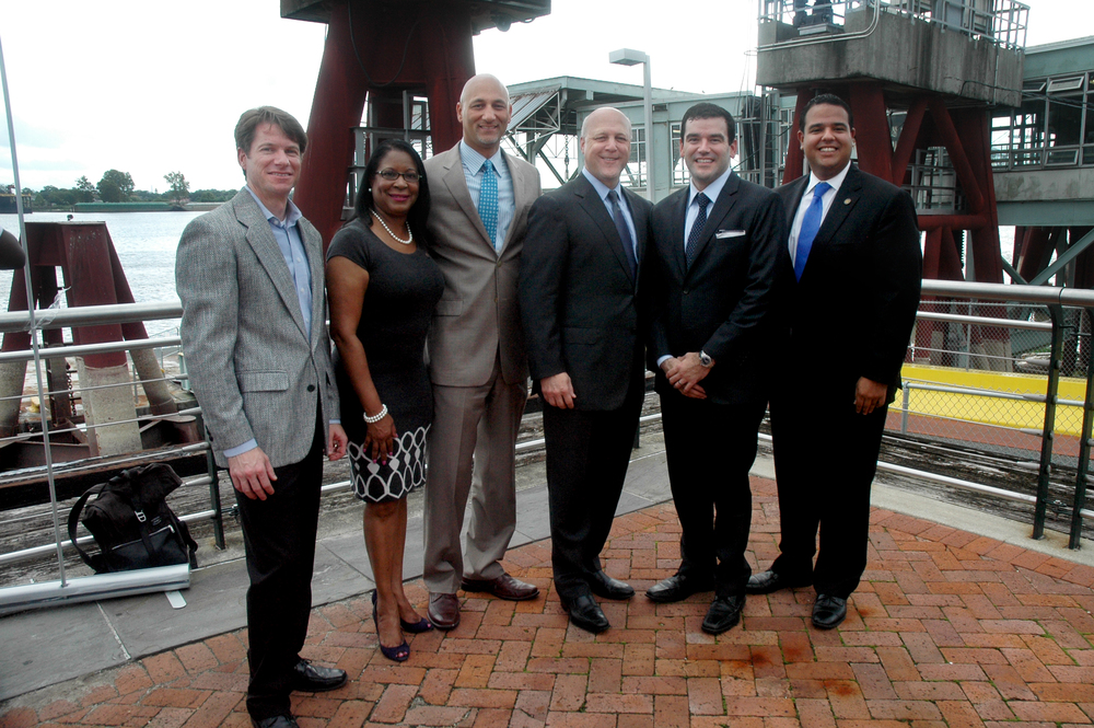 "Infinity Engineering Consultants principal partners and city officials gather in front of the old Canal Street Ferry Terminal after the announcement of the plans of a new terminal. From left, Infinity Principal Bill Thomassie; District ""C"" Councilmember Nadine Ramsey; Infinity Principal Raoul V. Chauvin, III; City of New Orleans Mayor Mitch Landrieu; Assistant Secretary of Transportation Policy Carlos Monje Jr.; and District ""B"" Councilmember Jared Brossett."