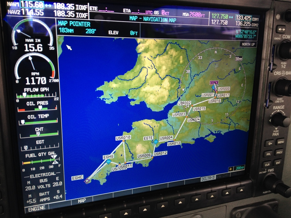 The flight plan from Oxford to Newquay and back via Exeter and Lands End, which we loaded manually into the Cessna's navigation system during our pre-flight planning. This screen, the MFD, shows an overview of the flight plan, as well as displaying critical engine parameters on the left, and communication/radio aid frequencies along the top.