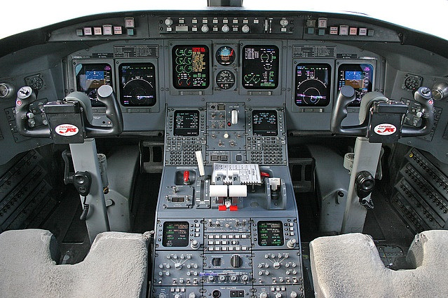 The flight deck of the Bombardier CRJ200 aircraft, identical to that of the simulator I am currently training in.