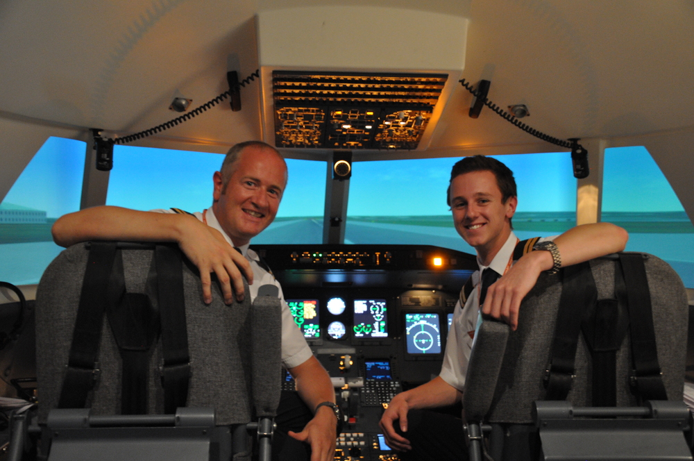 Sat on the ground at London Gatwick Airport, Runway 26L, in the CRJ200 simulator following a challenging sortie. On my left, my flight partner and Captain for the trip, Sir Timotheus Jane of Cornwallis, BSc, RAF.