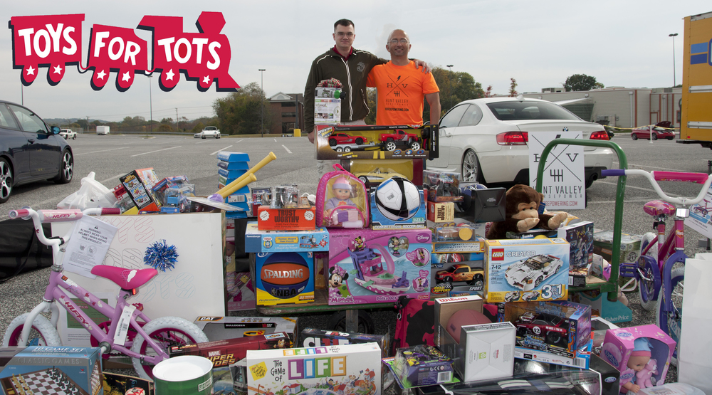 Toys For Tots Loading U-Haul + Big Logo.jpg