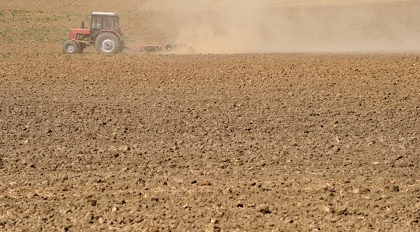 tractor on dirt, southwest drought farming, water 2025