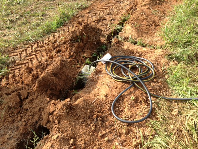 The first time I hooked a hose up... I wasn't about to wait for the trenches to be filled in