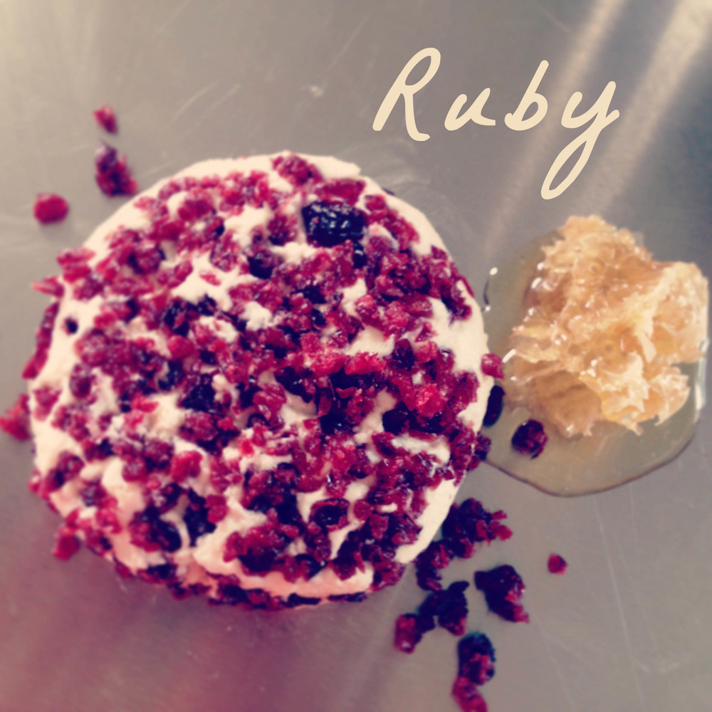 RUBY - honey infusedchèvre round, studded with cranberries